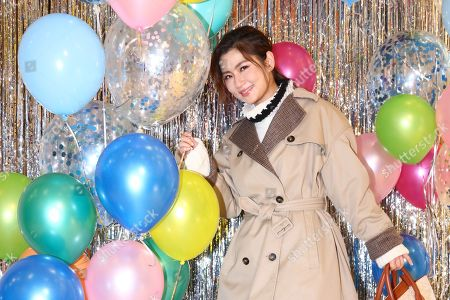 Selina Jen promotes for Tod's fw collection by wearing turtlenecks, trench coat and thigh boots