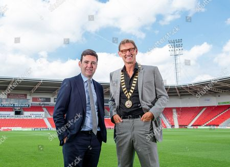 Andy Burnham hands the presidential chains of the Rugby Football League over to Tony Adams.