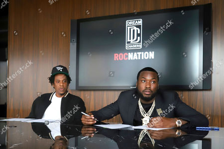Jay-Z, Meek Mill. Jay-Z, left, and Meek Mill make an announcement of the launch of Dream Chasers record label in joint venture with Roc Nation, at the Roc Nation headquarters, in New York