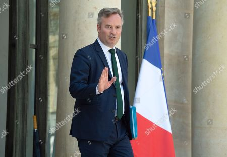 French Junior Minister for Foreign Affairs Jean-Baptiste Lemoyne waves as he leaves the last weekly cabinet meeting before the government goes on holidays, at the Elysee Presidential palace.