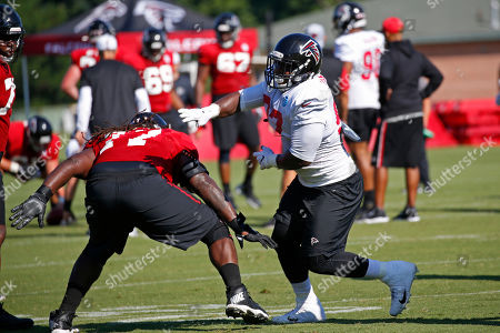 James Carpneter, Grady Jarrett. Atlanta Falcons offensive guard James Carpenter (77) tries to block defensive tackle Grady Jarrett (97), right, during their NFL training camp football practice, in Flowery Branch, Ga