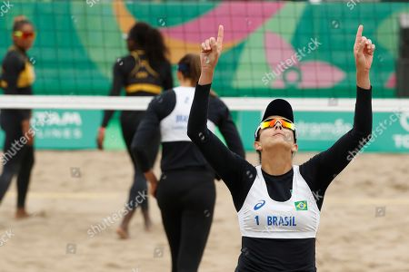 Carolina Horta (R) and Angela Reboucas of Brazil celebrate a point against Melanie Valenciana and Charles Mannika of Virgin Islands during their Beach-Volleyball match at the Pan American Lima 2019 games in Costa Verde beach in Lima, Peru, 24 July 2019. The Lima 2019 Pan American Games will run from 26 July to 11 August.