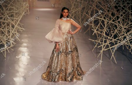 Stock Photo of Bollywood actress Aditi Rao Hydari displays a creation by Indian designers Pankaj & Nidhi during the India Couture Week in New Delhi, India