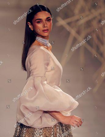 Bollywood actress Aditi Rao Hydari displays a creation by Indian designers Pankaj & Nidhi during the India Couture Week in New Delhi, India