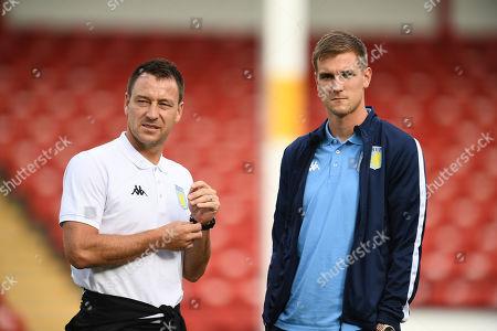 John Terry assistant head coach of Aston Villa with Bjorn Engels of Aston Villa.