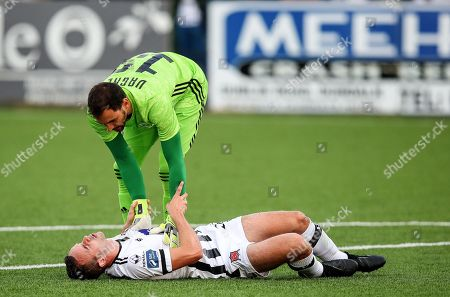 Dundalk vs Qarabag. Dundalk's Robbie Benson down injured as Vagner of Qarabag checks on him