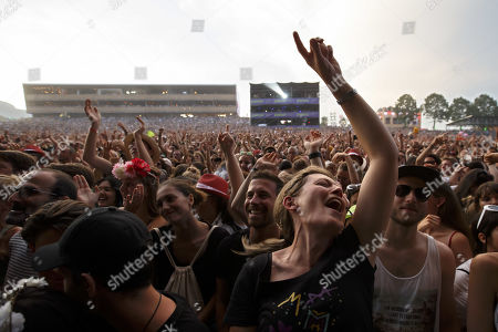 Festival goers cheer as French singer Matthieu Chedid, known as M, performs on the main stage, during the 44th edition of the Paleo Festival, in Nyon, Switzerland, 23 July 2019. The Paleo is an open-air music festival in the western part of Switzerland that runs from 23 to 28 July.