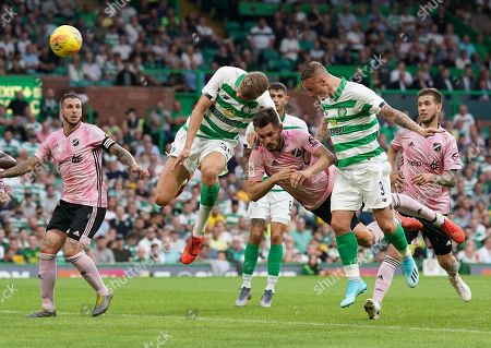 Kristoffer Ajer of Celtic heads the ball into the net ahead of team mate Leigh Griffiths to give Celtic a 1-0 lead.