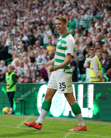 Kristoffer Ajer of Celtic celebrates after heading the ball into the net ahead of team mate Leigh Griffiths to give Celtic a 1-0 lead.