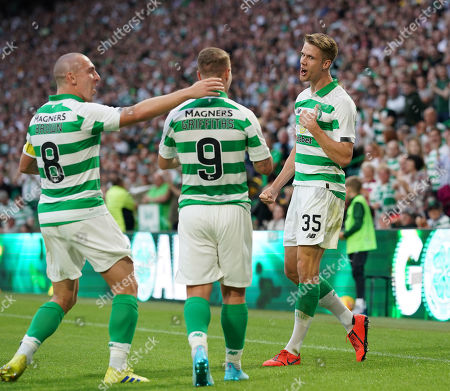 Kristoffer Ajer of Celtic reminds team mate Leigh Griffiths that it was Ajer who scored to give Celtic a 1-0 lead and not Griffiths as they celebrate.