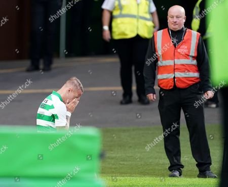 Leigh Griffiths of Celtic falls to his knees amid emotional celebrations after he scored to give Celtic a 3-0 lead. Griffiths has just returned to the team following a period out with mental health issues.