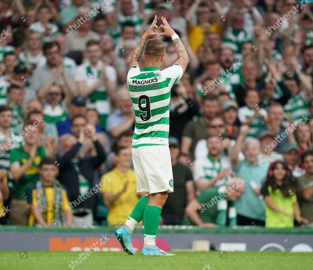 Leigh Griffiths of Celtic makes a love heart shape with his hands and gestures towards his family in the stand amid emotional celebrations after scoring to give Celtic a 3-0 lead. Griffiths has just returned to the team following a period out with mental health issues.
