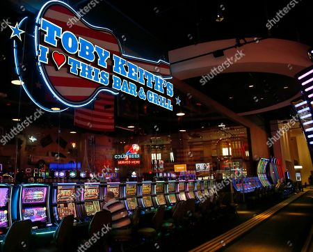 A Toby Keith's Bar and Grill is situated near slot machines in the casino at the WinStar World Casino and Resort in Thackerville, Okla