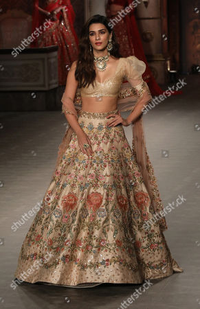 Indian actress Kriti Sanon presents a creation by Indian designers Shyamal and Bhumika during the FDCI India Couture Week 2019 in Partnership with HT in New Delhi, India, 25 July 2019. FDCI India Couture Week 2019 is scheduled from 22 to 28 July.