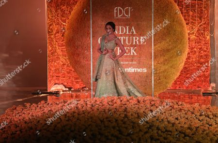 Indian actress Malaika Arora presents a creation by Indian designer Sulakshana Monga during the FDCI India Couture Week 2019 in Partnership with HT in New Delhi, 25 July 2019. FDCI India Couture Week 2019 is scheduled from 22 to 28 July.