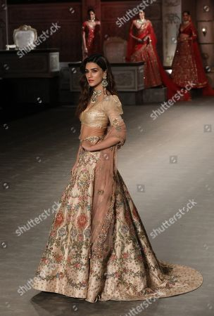 Indian actress Kriti Sanon presents a creation by Indian designers Shyamal and Bhumika during the FDCI India Couture Week 2019 in Partnership with HT in New Delhi, 25 July 2019. FDCI India Couture Week 2019 is scheduled from 22 to 28 July.