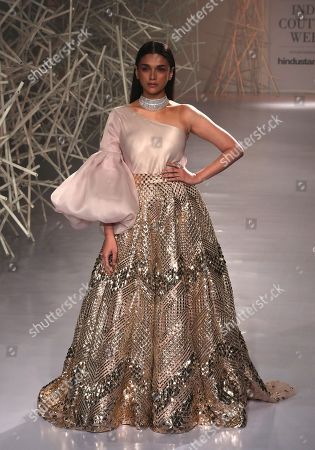Stock Picture of Indian actress Aditi Rao Hydari presents a creation by Indian designers Pankaj and Nidhi during the FDCI India Couture Week 2019 in Partnership with HT in New Delhi on 24 July  2019. FDCI India Couture Week 2019 is scheduled from 22 to 28 July.