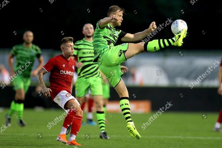 Matthew Mills of Forest Green Rovers clears the ball