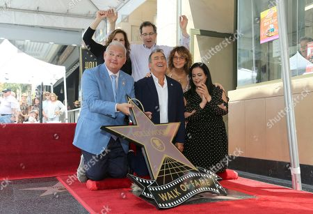 Jeff Zarrinnam, Kathy Najimy, Gary Marsh, Kenny Ortega, Jennifer Grey, Rana Ghadban. Jeff Zarrinnam, from left, Kathy Najimy, Gary Marsh, Kenny Ortega, Jennifer Grey and Rana Ghadban unveil a star during a ceremony honoring Kenny Ortega with a star at the Hollywood Walk of Fame, in Los Angeles