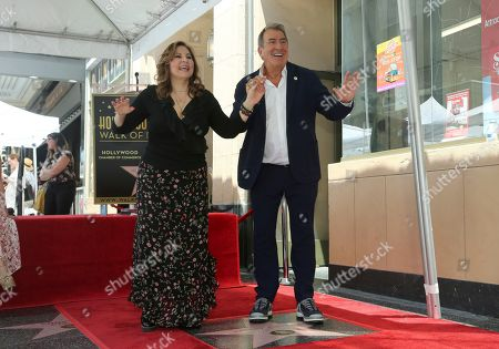 Kathy Najimy, Kenny Ortega. Kathy Najimy, left, and Producer-director Kenny Ortega dance during a ceremony honoring Ortega with a star at the Hollywood Walk of Fame, in Los Angeles