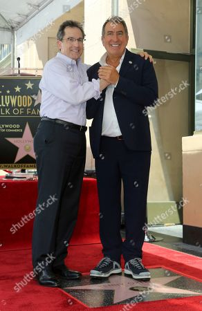 Gary Marsh, Kenny Ortega. Gary Marsh, left, and Kenny Ortega pose atop a star right after the ceremony honoring Kenny Ortega with a star at the Hollywood Walk of Fame, in Los Angeles