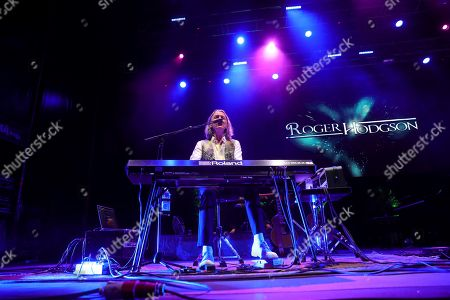 Stock Photo of British musician and founder of British band Supertramp Roger Hodgson performs on stage during his concert at the Las Noches del Botanico Festival in Madrid, Spain, 24 July 2019.