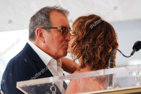 Jennifer Grey (R) and US producer Kenny Ortega kiss prior to the unveiling his 2,667th star on the Hollywood Walk of Fame in Hollywood, California, USA, 24 July 2019. The star was dedicated in the Category of Motion Pictures.