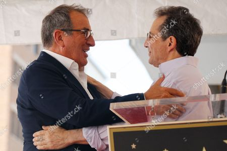 President of Disney Channels Worldwide Gary Marsh (R) interacts with US producer Kenny Ortega prior to the unveiling of his 2,667th star on the Hollywood Walk of Fame in Hollywood, California, USA, 24 July 2019. The star was dedicated in the Category of Motion Pictures.