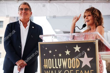 Jennifer Grey (R) delivers a speech prior to the unveiling of US producer Kenny Ortega's 2,667th star on the Hollywood Walk of Fame in Hollywood, California, USA, 24 July 2019. The star was dedicated in the Category of Motion Pictures.