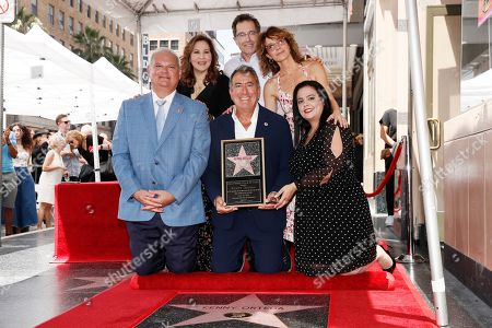 Kathy Najimy, President of Disney Channels Worldwide Gary Marsh, US actress Jennifer Grey and US producer Kenny Ortega (C front) pose together during the unveiling of Ortegaâ??s 2,667th Star on the Hollywood Walk of Fame in Hollywood, California, USA, 24 July 2019. The star was dedicated in the Category of Motion Pictures.