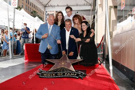 Kathy Najimy, President of Disney Channels Worldwide Gary Marsh, US actress Jennifer Grey and US producer Kenny Ortega (C front) unveil Ortegaâ??s 2,667th Star on the Hollywood Walk of Fame in Hollywood, California, USA, 24 July 2019. The star was dedicated in the Category of Motion Pictures.