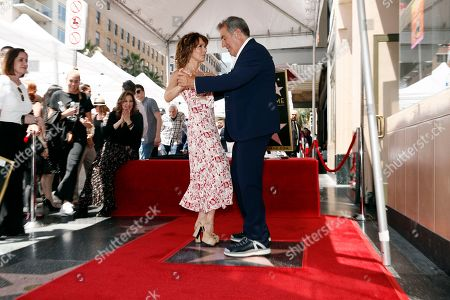 Kenny Ortega (R) and US actress Jennifer Grey dance together during the unveiling of his 2,667th Star on the Hollywood Walk of Fame in Hollywood, California, USA, 24 July 2019. The star was dedicated in the Category of Motion Pictures.
