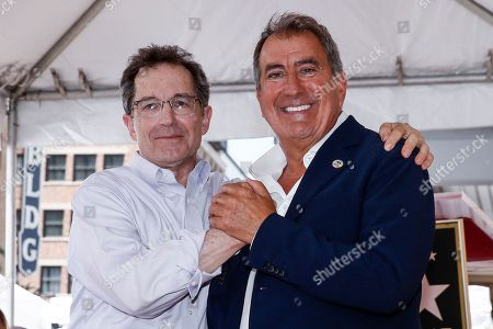Kenny Ortega (R) and President of Disney Channels Worldwide Gary Marsh dance together during the unveiling of his 2,667th Star on the Hollywood Walk of Fame in Hollywood, California, USA, 24 July 2019. The star was dedicated in the Category of Motion Pictures.
