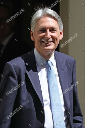 Philip Hammond, Chancellor of the Exchequer shakes hands with his staff as he leaves Number 11 Downing Street to go to Prime Ministers Questions in the House of Commons