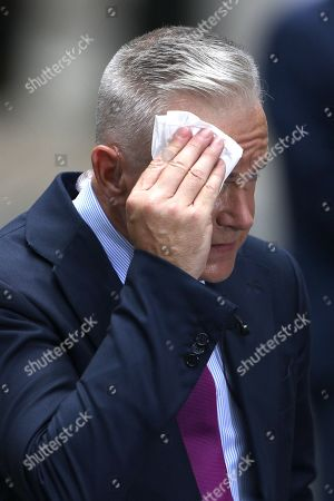 Huw Edwards mops his brow