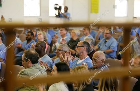 Inmates applaud after watching filmmaker Ken Burns' new Country Music documentary at San Quentin State Prison in San Quentin, Calif. Burns visited the prison to show parts of his new documentary, Country Music, that premieres Sept. 15 on PBS. The clips shown at the prison included sections from the film about Johnny Cash's iconic performances at San Quentin, one of which inspired then-inmate Merle Haggard to pursue his own music career