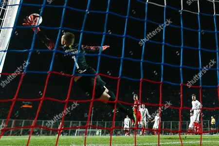 Stock Image of Goalkeeper Juan Pablo Carrizo from Cerro Porteno saves a shot during the Copa Libertadores match at the Pedro Bidegain stadium in Buenos Aires, Argentina, 24 July 2019.