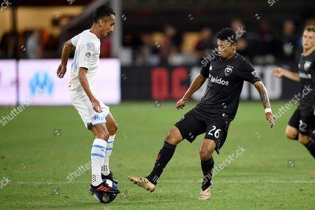 D.C. United midfielder Antonio Bustamante (26) battles for the ball against Marseille midfielder Saif-Eddine Khaoui, left, during the second half of an international friendly soccer match, in Washington