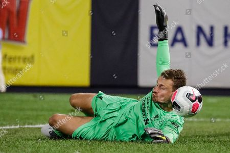 Liverpool FC's goalkeeper Simon Mignolet stops a shot on the goal during the first half of a soccer match against Sporting CP, in New York