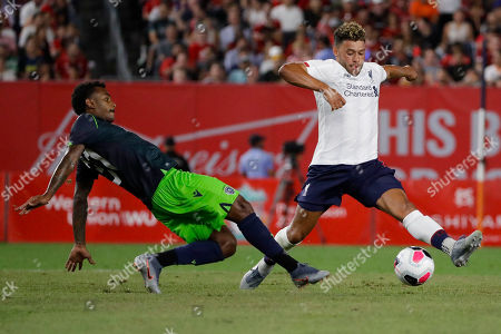 Stock Image of Sporting CP's Marcus Wendel, left, fights for control of the ball with Liverpool FC's Daniel Sturridge during the second half of a soccer match, in New York. The game ended 2-2