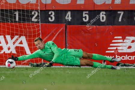 Liverpool FC goalkeeper Simon Mignolet deflects a shot on the goal during the second half of a soccer match against the Sporting CP, in New York. The game ended 2-2