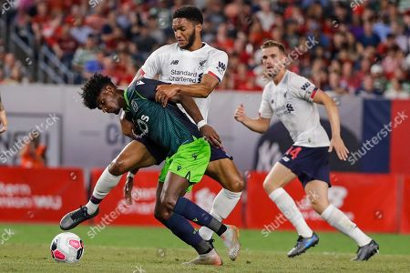 Stock Picture of Sporting CP's Thierry Correia, left, fights for control of the ball with Liverpool FC's Joe Gomez as teammate Daniel Sturridge, right, watches during the second half of a soccer match, in New York. The game ended 2-2