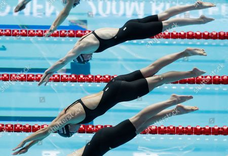 United States' Katie Drabot, foreground, starts in the women's 200m butterfly final at the World Swimming Championships in Gwangju, South Korea