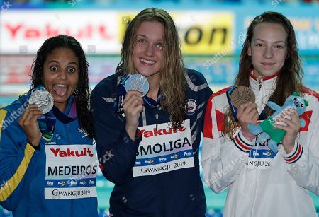 Gold medalist United States' Olivia Smoliga, centre, stands with silver medalist Brazil's Etiene Medeiros, left, and bronze medalist Russia's Daria Vaskina following the World Swimming Championships in Gwangju, South Korea