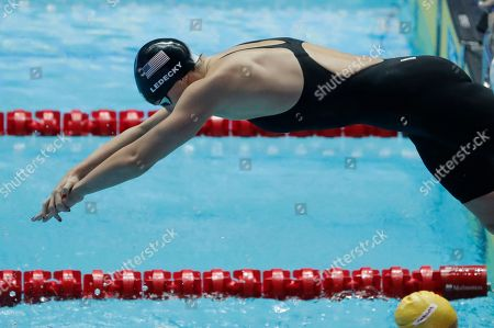 United States' Katie Ledecky dives in for her leg of the women's 4x200m freestyle relay at the World Swimming Championships in Gwangju, South Korea