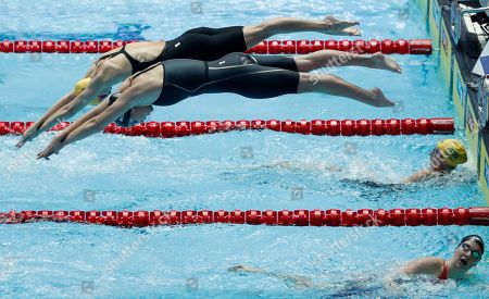 Australia's Emma McKeon and United States Katie McLaughlin dive in together for the final leg of the women's 4x200m relay final at the World Swimming Championships in Gwangju, South Korea