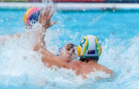 Blake Edwards of Australia (R) in action against Alexandros Papanastasiou of Greece (L) during the men's water polo classification 5-8 match between Australia and Greece at the FINA Swimming World Championships 2019 in Gwangju, South Korea, 25 July 2019.