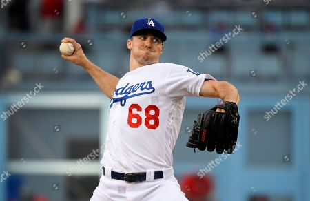 Los Angeles Dodgers starting pitcher Ross Stripling throws to the plate during the first inning of a baseball game against the Los Angeles Angels, in Los Angeles