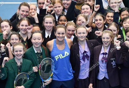 French Open winner and world number one tennis player Ashleigh Barty (C) poses for photos during a welcome home event at Pat Rafter Arena in Brisbane, Australia, 25 July 2019. Queensland Premier Annastacia Palaszczuk and 70 junior tennis players officially welcomed home Ashleigh Barty to Australia after her recent French Open win.