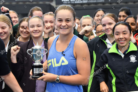 Stock Image of French Open winner and world number one tennis player Ashleigh Barty (C) poses for photos during a welcome home event at Pat Rafter Arena in Brisbane, Australia, 25 July 2019. Queensland Premier Annastacia Palaszczuk and 70 junior tennis players officially welcomed home Ashleigh Barty to Australia after her recent French Open win.